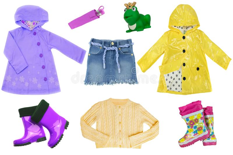 Collage set of little girl clothes isolated on a white background. The collection of  rain jackets, sweater, a jeans skirt, rubber. Boots and other equipment stock photo