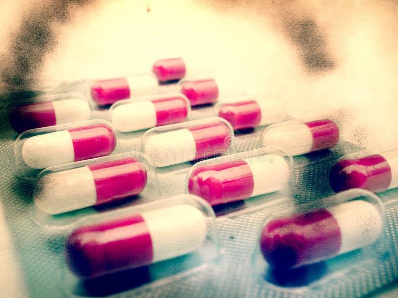 Collage strutturato di lerciume - pillole fotografia stock