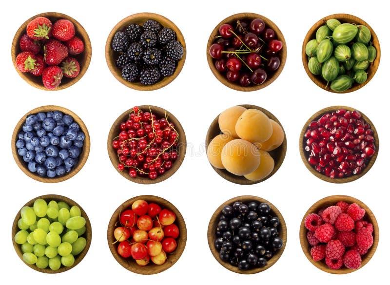 Collage van vruchten en bessen op een witte achtergrond worden geïsoleerd die Hoogste mening royalty-vrije stock afbeeldingen