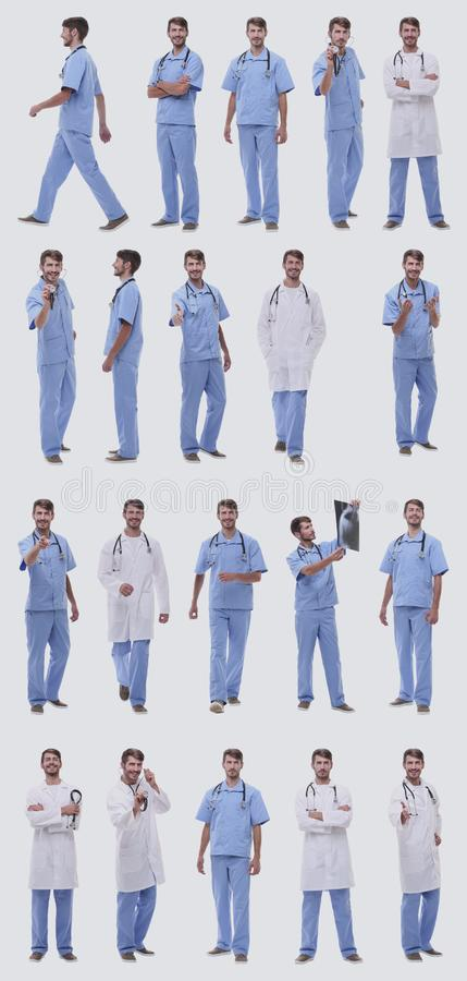 Collage of a variety of medical doctors standing in a row royalty free stock image