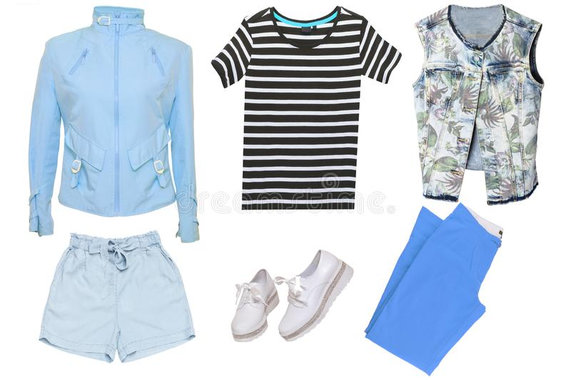 Collage woman clothes. Set of a sporty stylish and trendy women jacket, a blouse or shirt, white shoes, a shorts and a folded royalty free stock images