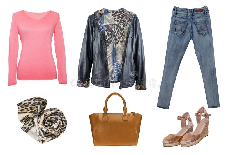 Collage woman clothes. Set of stylish and trendy women jacket, sweater or blouse, jeans, shoes and accessories isolated on a white royalty free stock photo