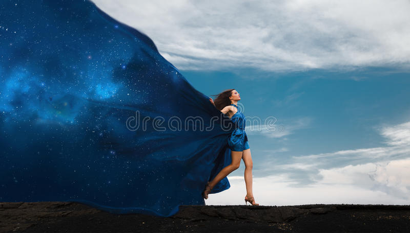 Collage with woman in dress and space dress. Day and night. royalty free stock photography