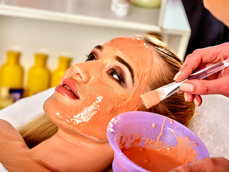 Collagen face mask. Facial skin treatment. Woman receiving cosmetic procedure. Collagen face mask. Facial skin treatment. Woman receiving cosmetic procedure in royalty free stock image