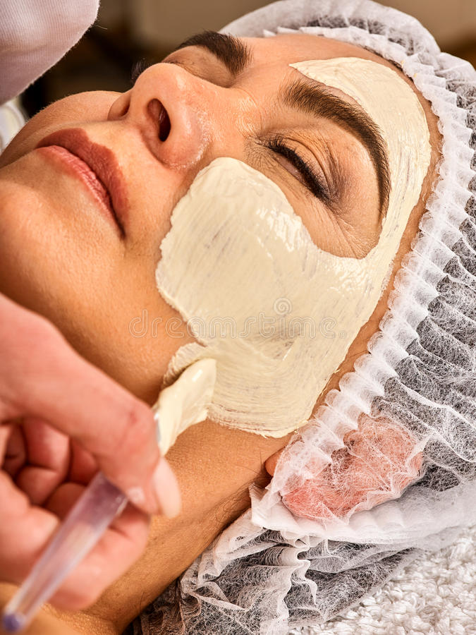 Collagen face mask . Facial skin treatment. Woman receiving cosmetic procedure. royalty free stock photos
