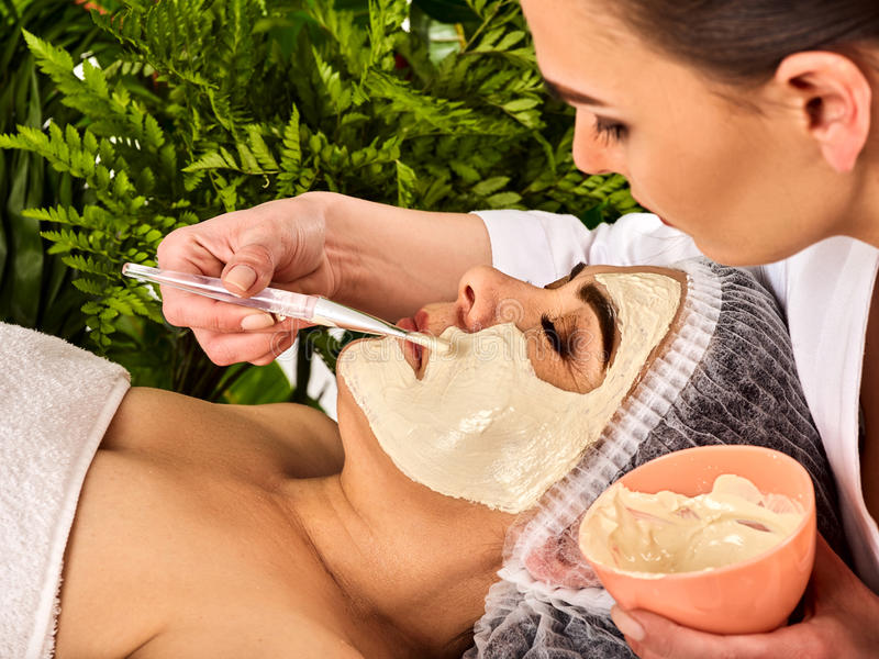 Collagen face mask . Facial skin treatment. Woman receiving cosmetic procedure. Collagen face mask. Facial skin treatment. Face of women of elderly women 50-60 royalty free stock photos