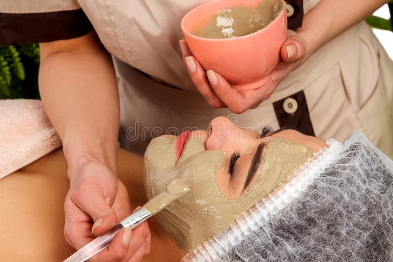 Collagen face mask. Facial skin treatment. Woman receiving cosmetic procedure. Collagen face mask. Facial skin treatment. Face of women of elderly women 50-60 stock image