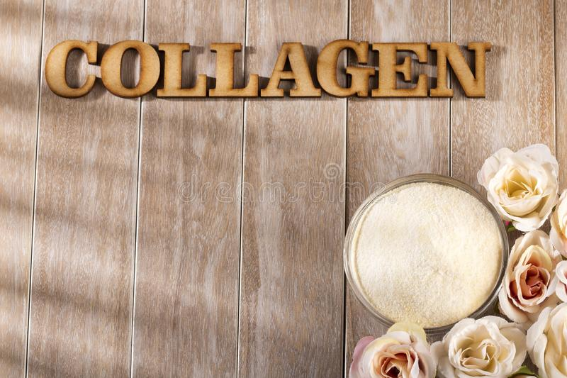 Collagen protein powder - Hydrolyzed. Collagen word in wooden letters royalty free stock photos