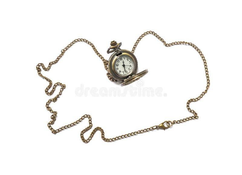 Collana d'ottone dell'orologio del primo piano isolata su fondo bianco fotografia stock libera da diritti
