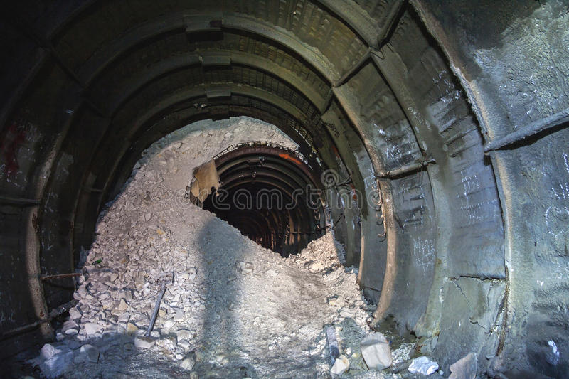 The collapse in the chalk mine, tunnel with traces of drilling machine royalty free stock photo