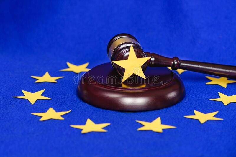Collapse of the European Union. Free Europe and out of it.Mild brexit Europe. EU flag on the background of the judge`s gavel. Collapse of the European Union stock image