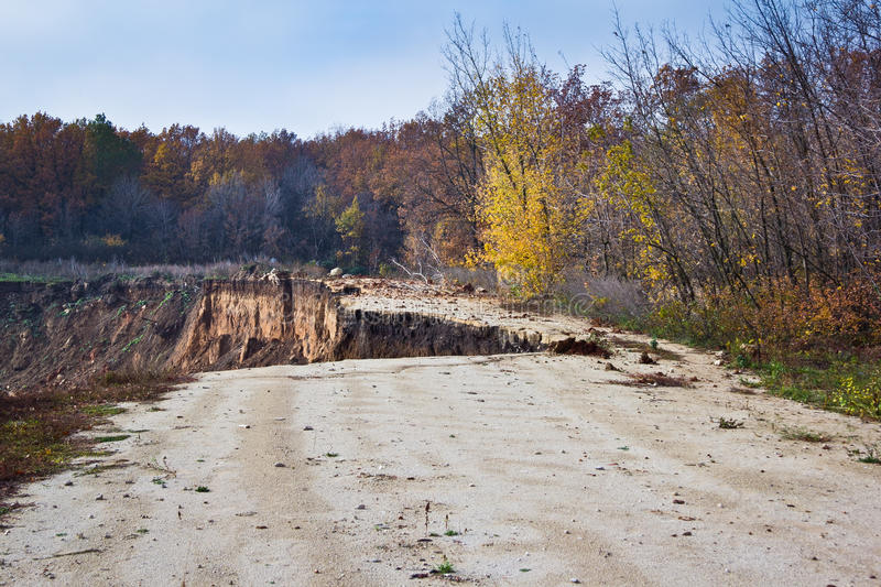 The collapse of the road as a result of erosion. End of the road royalty free stock image