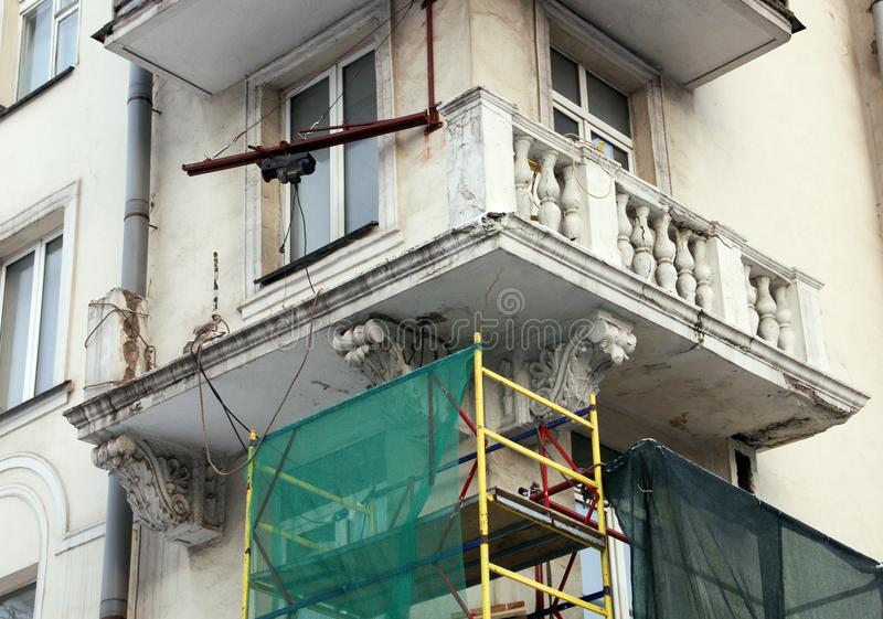 Collapsed balcony. Of an old apartment house in the stage of repair and reconstruction royalty free stock images