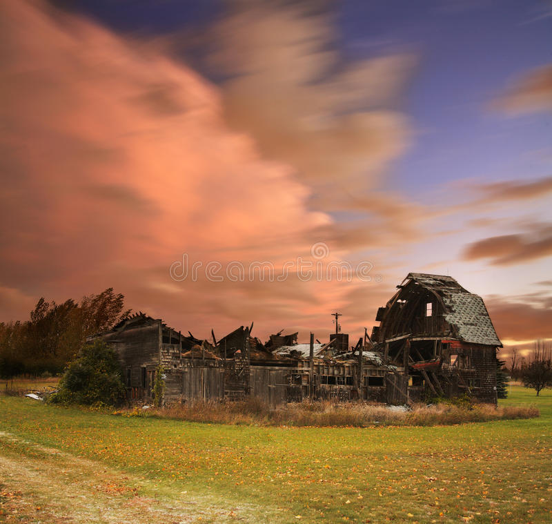 Collapsed Barn In Michigan. A Dramatic Cloudscape Of Restless Skies Above An Old Collapsed Barn Near Northport Michigan On A Stormy Day In Autumn, USA royalty free stock photo