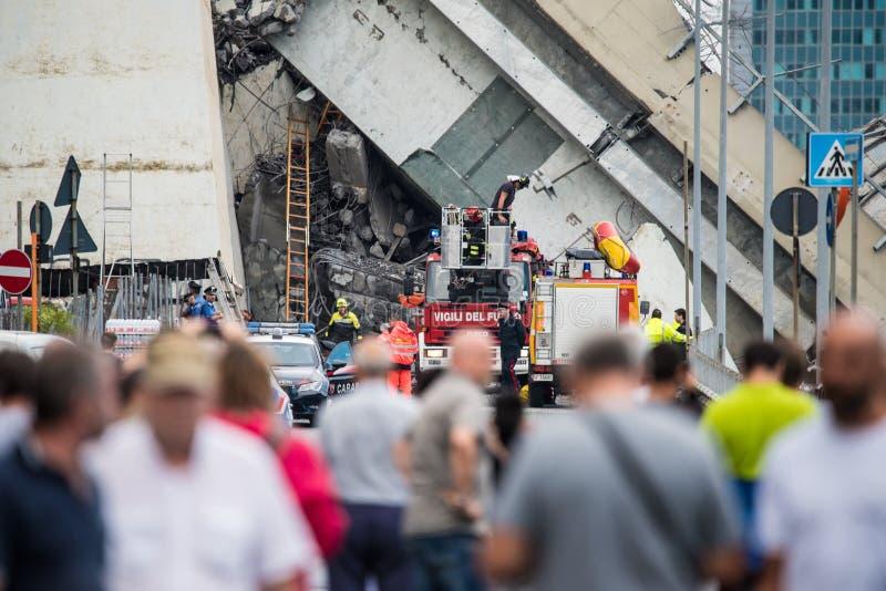 Rescue workers on the Morandi bridge in Genoa, Italy. The collapsed bridge Morandi, the A10 highway suspension bridge in the city of Genova, Italia. Collapsed on royalty free stock photo