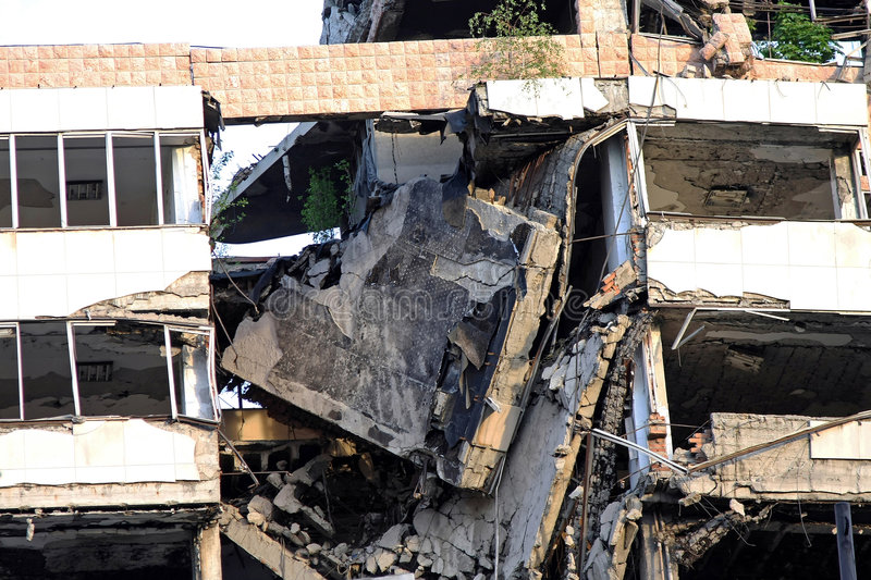 Collapsed building. Collapsed big building after strong earthquake disaster stock image