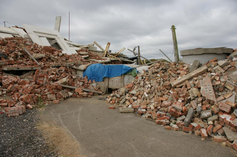 Collapsed building. The bricks and materials of a collapsed building in a disaster zone royalty free stock photos