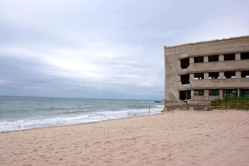 Collapsed building on the seaside stock photography