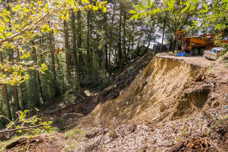 Collapsed paved road due to a landslide as result of heavy rains, San Francisco bay area, California stock photography