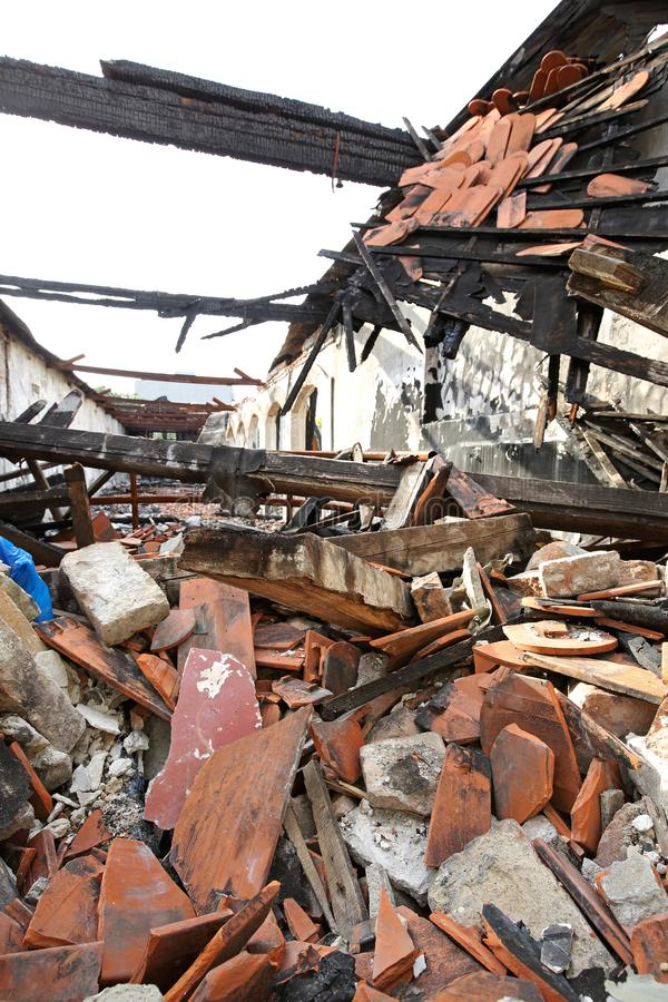Collapsed Roof. And Burned Wooden Structure in Factory After Fire stock image