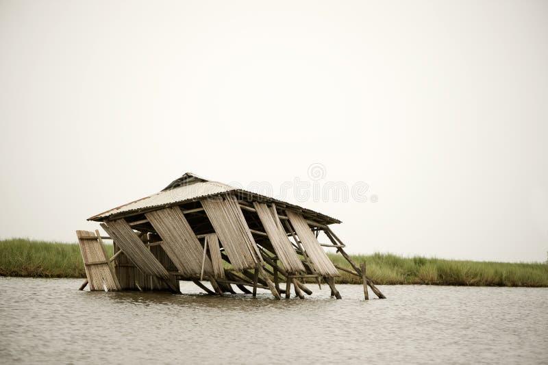 Collapsed stilt house. On the lagoon of Ganvie in Benin stock photos