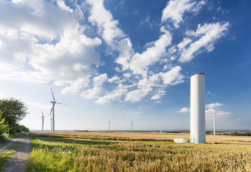 Collapsed Wind Turbine In Wind Park. A halfway deconstructed wind turbine in a wind park that collapsed during a storm in the Eifel, Germany royalty free stock photo