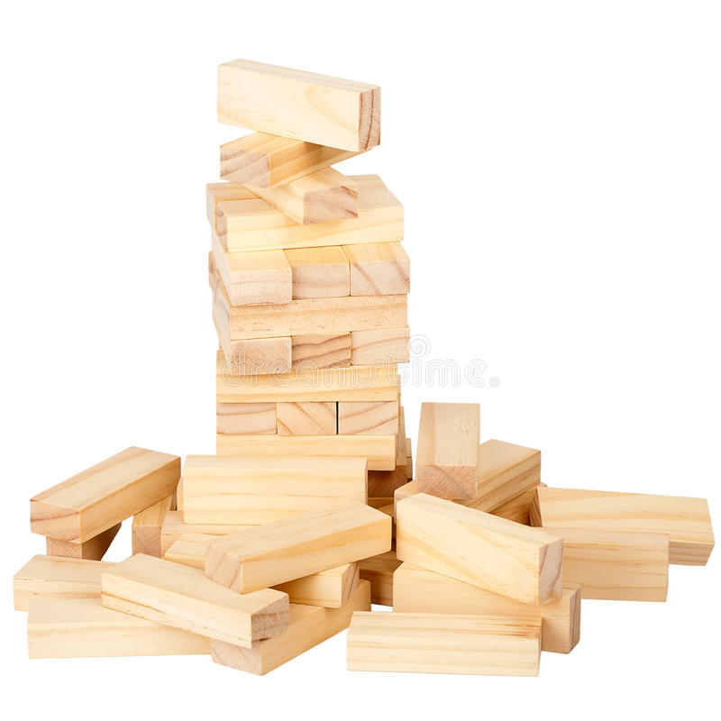 Collapsed wooden blocks tower. Isolated on white background stock image
