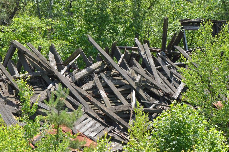 Collapsed Wooden Building. Weathered remains of a collapsed wooden building stock photography
