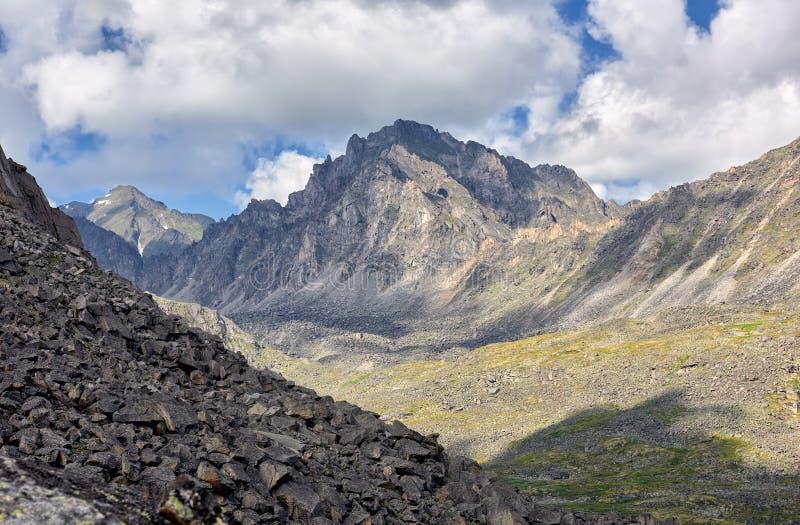 Collapsing peak under influence of weathering erosion stock images