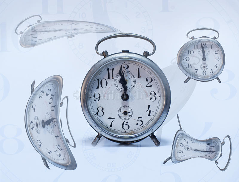 Collapsing time. Conceptual picture with few clocks and the time collapsing stock image