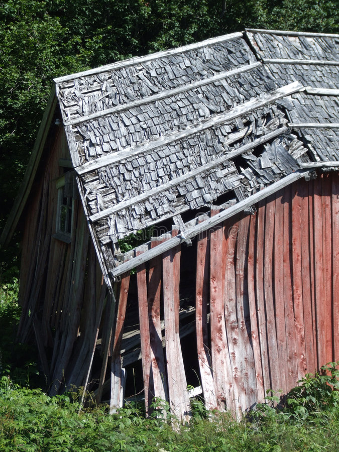 Collapsing wooden house royalty free stock photo