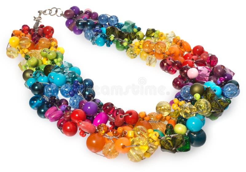Collar con los cristales y las gotas multicolores imagen de archivo