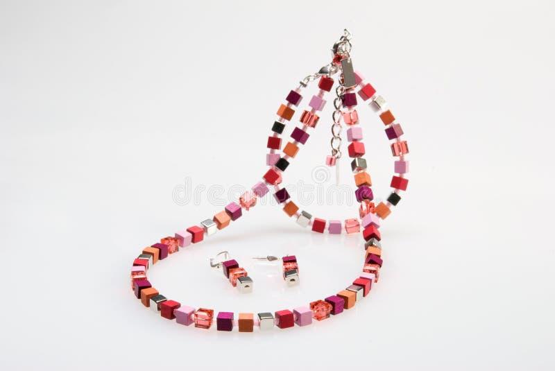 Collar, pulsera y pendientes coloridos foto de archivo libre de regalías