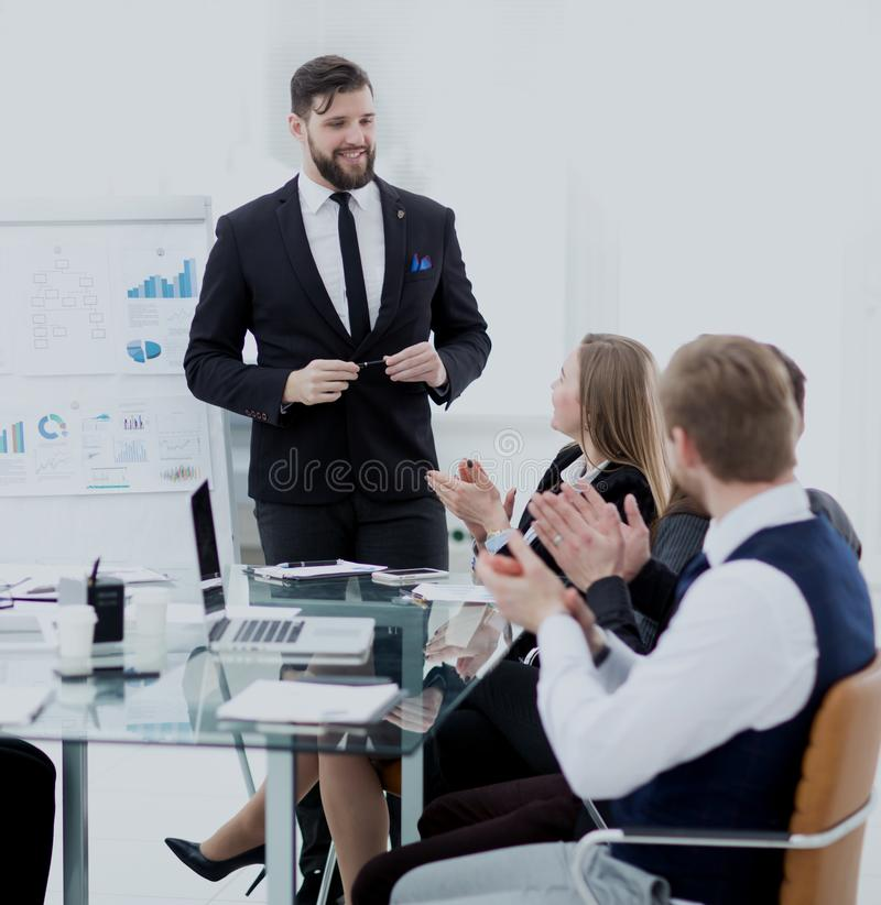 Colleagues applaud the project Manager after the working meeting royalty free stock photos