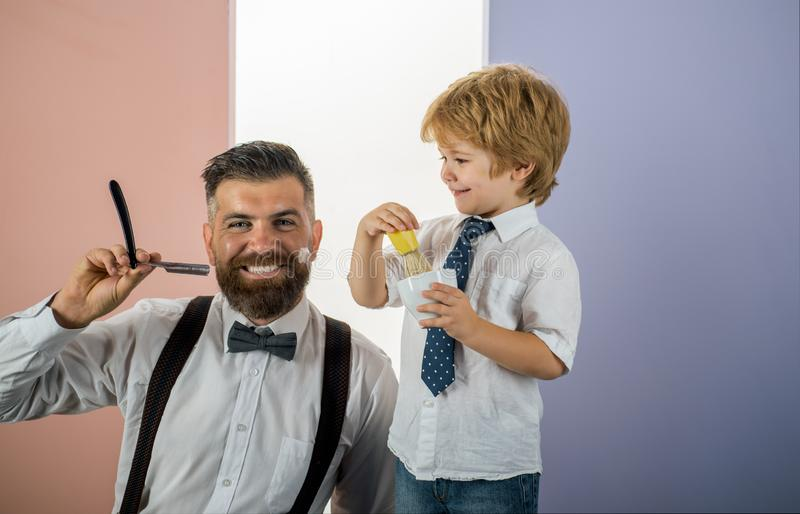 Colleagues in the barbershop. Male style. Father and son together. Hair style and hair stylist. Man visiting hairstylist stock photos