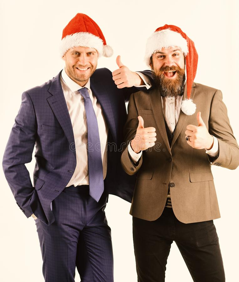 Colleagues with beards have Christmas meeting. Men in classic suits stock photography