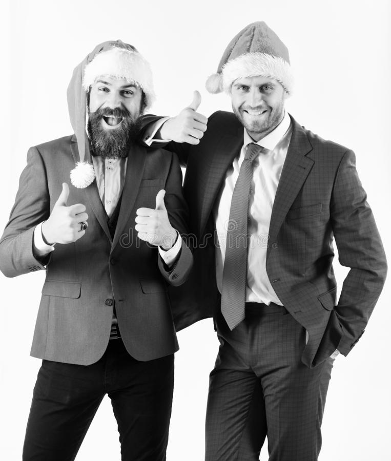 Colleagues with beards have Christmas meeting. Men in classic suits stock images