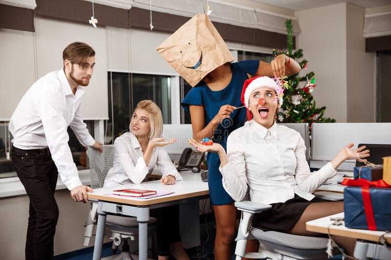 Colleagues celebrating christmas party in office drinking champagne smiling. stock image