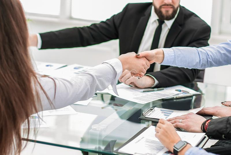 Colleagues confirming the job with a handshake. Teamwork stock photo