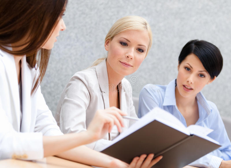Download Colleagues Discuss Business Plan Stock Photo - Image: 26756784