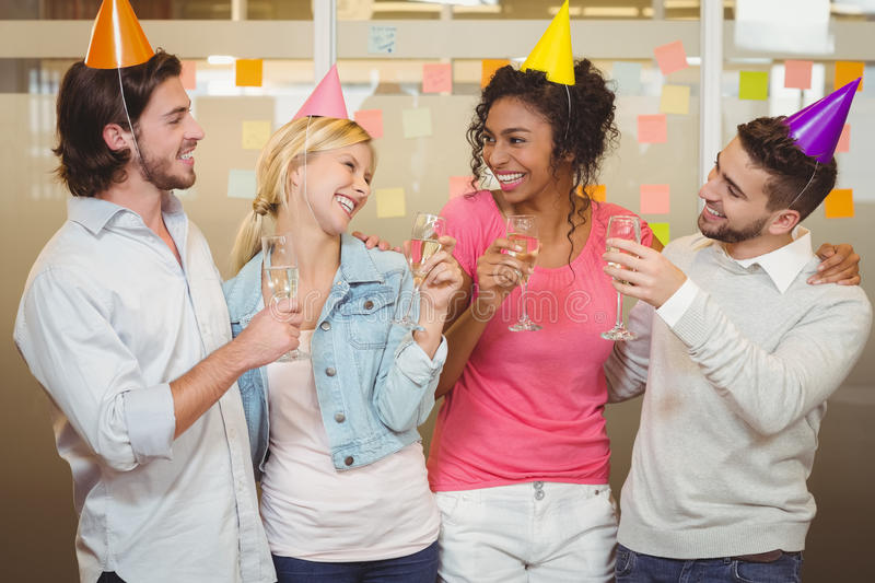 Colleagues enjoying birthday party with champagne stock images