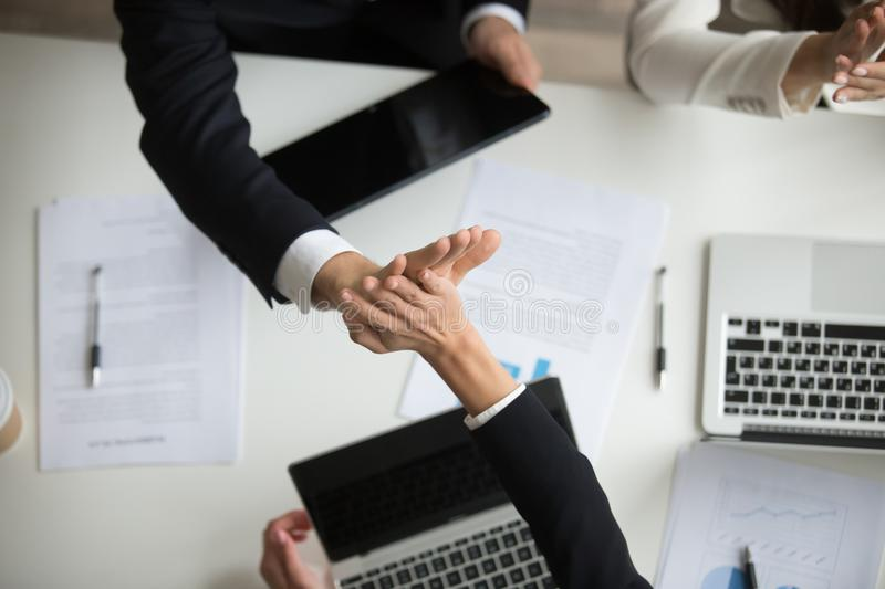 Colleagues giving high-five celebrating good teamwork result, to stock photography