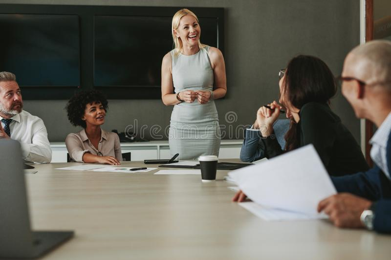 Business team having a meeting in conference room stock images