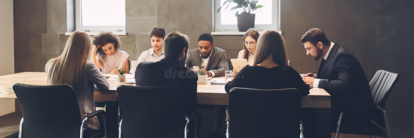 Colleagues having meeting and discussion in boardroom royalty free stock photos