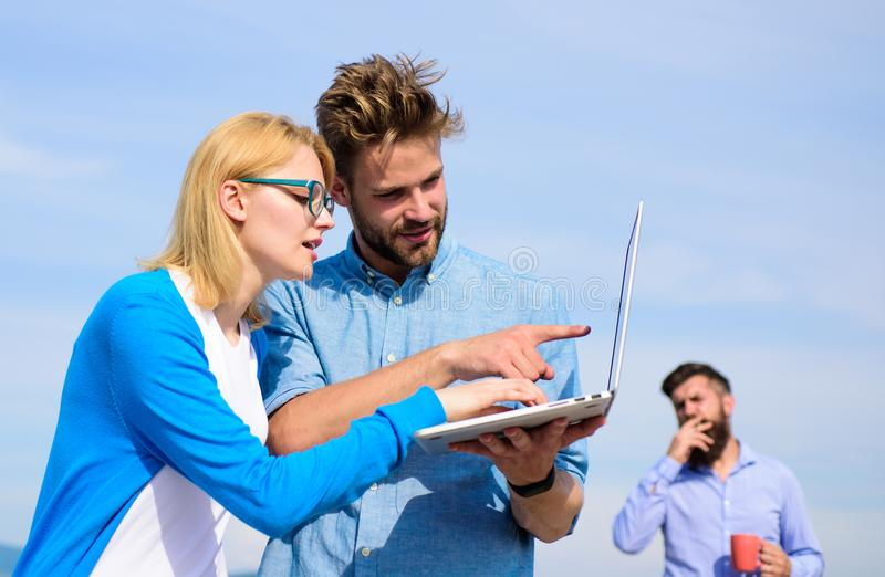 Colleagues laptop work outdoor sunny day, sky background. Colleagues with laptop discussing plan. Fresh air helps to. Refresh mind. Deadline concept. Friends royalty free stock images