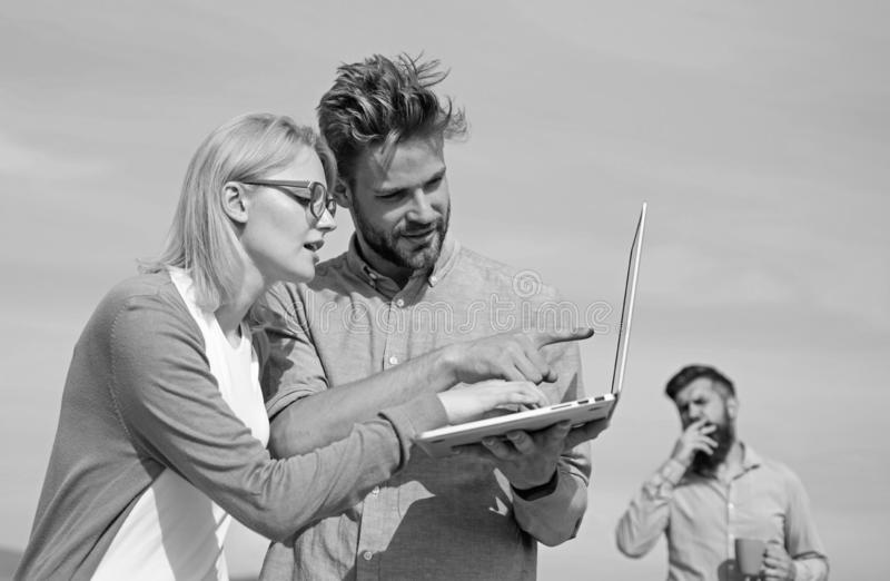 Colleagues laptop work outdoor sunny day, sky background. Colleagues with laptop discussing plan. Fresh air helps to. Refresh mind. Deadline concept. Friends royalty free stock photos
