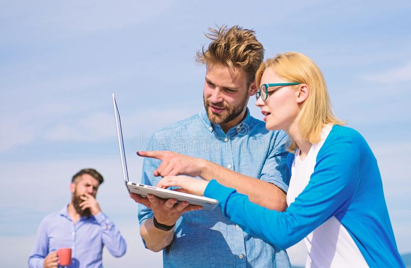 Colleagues laptop work outdoor sunny day, sky background. Colleagues with laptop discussing plan. Fresh air helps to. Refresh mind. Deadline concept. Friends royalty free stock photography