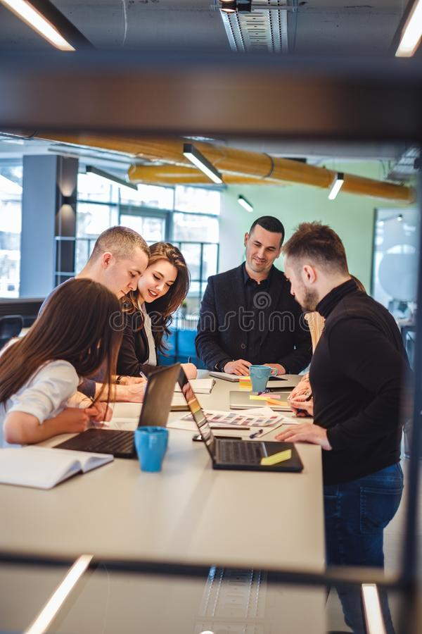 Colleagues looking at documents at office meeting royalty free stock photo