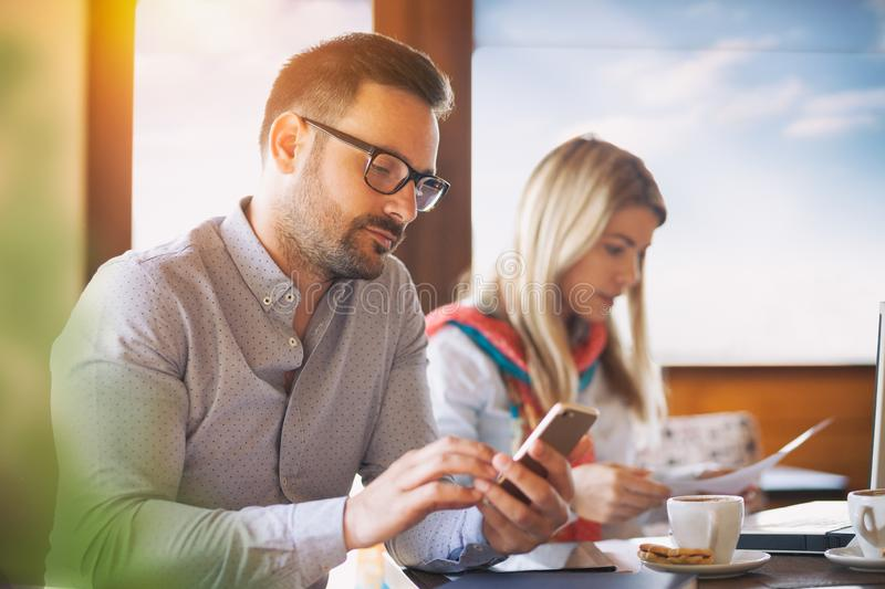 Colleagues making a break in a coffee bar stock photography