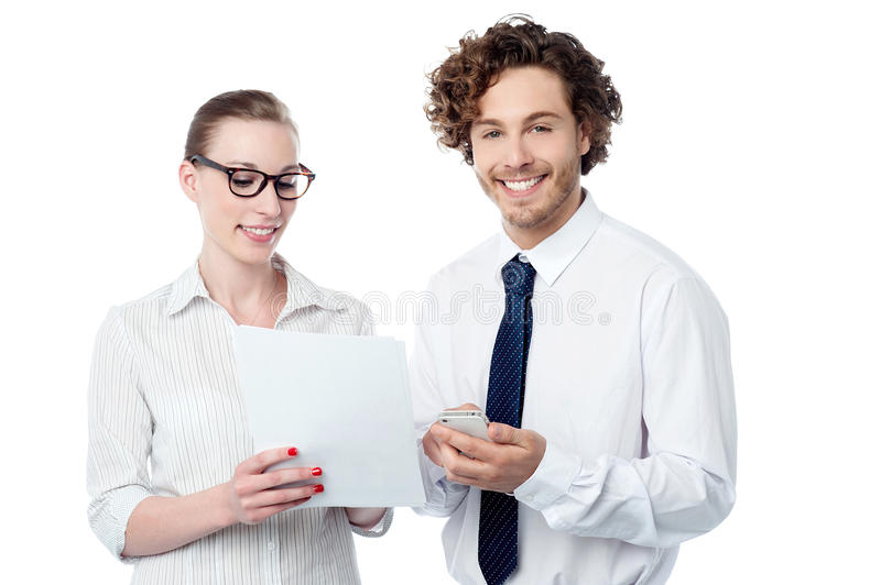 Colleagues reviewing business reports. Business executives analyzing annual report stock image